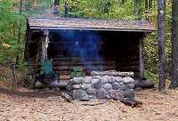 Adirondack lean to, with cooking fire.